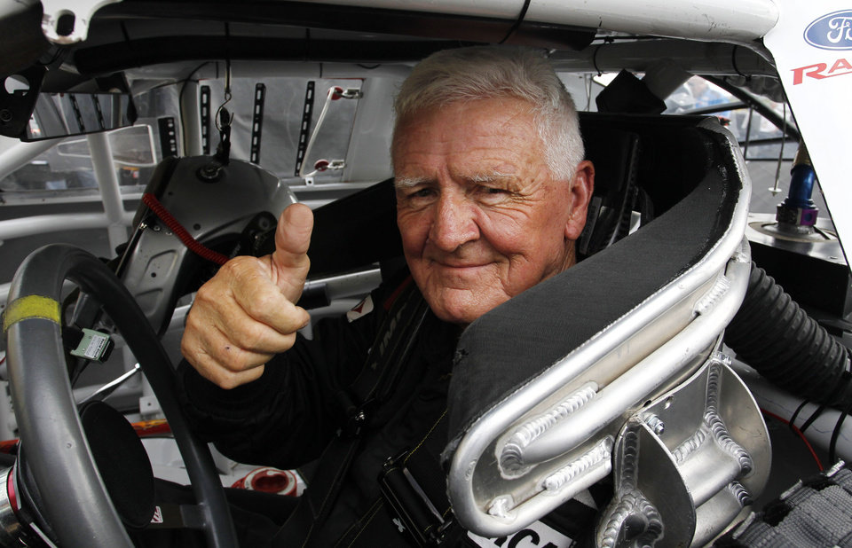 Photo - ARCA driver James Hylton gives a thumbs up while sitting in his race car during practice at Kansas Speedway in Kansas City, Kan., Friday, Oct. 4, 2013. The 79-year-old will retire following Friday's ARCA Kansas Lottery 98.9 race. (AP Photo/Colin E. Braley)