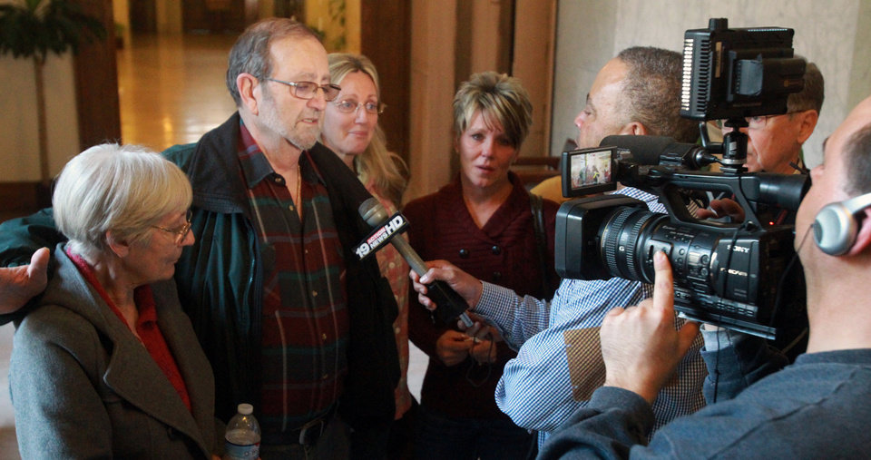 Jack Kern, second from left, addresses the media with his wife, Ellen, left, and daughter Barbara, after the jury recommended death for Richard Beasley in the courtroom of Summit County Common Pleas Court Judge Lynne Callahan, Wednesday, March 20, 2013, in Akron, Ohio. Kern\'s son, Tim, was one of the victims. Beasley, a self-styled street preacher, was convicted of killing three down-and-out men lured by bogus Craigslist job offers. (AP Photo/Akron Beacon Journal, Michael Chritton, Pool)
