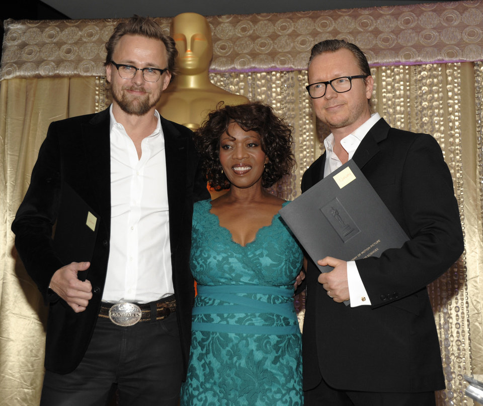 Photo - From left to right, director Joachim Roenning, actress Alfre Woodard and director Espen Sandberg pose together during the The Oscars Foreign Language Film Award Directors Reception at The Academy of Motion Picture Arts and Sciences in Beverly Hills, Calif. on Friday, Feb. 22, 2013. Roenning and Sandberg's feature film