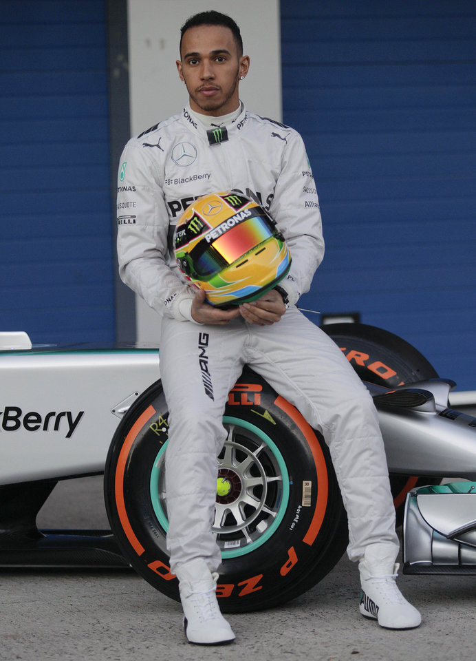 Photo - Mercedes GP driver Lewis Hamilton of Great Britain attends the launch of his new Mercedes W05 Formula One car at the Circuito de Jerez in Jerez de la Frontera, Spain, on Tuesday, Jan. 28, 2014. (AP Photo/Miguel Angel Morenatti)