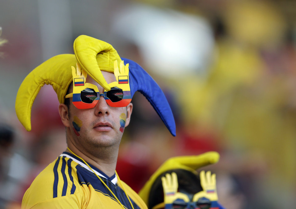 Photo - A Colombia's fan waits for the start of the group C World Cup soccer match between Colombia and Ivory Coast at the Estadio Nacional in Brasilia, Brazil, Thursday, June 19, 2014.  (AP Photo/Themba Hadebe)