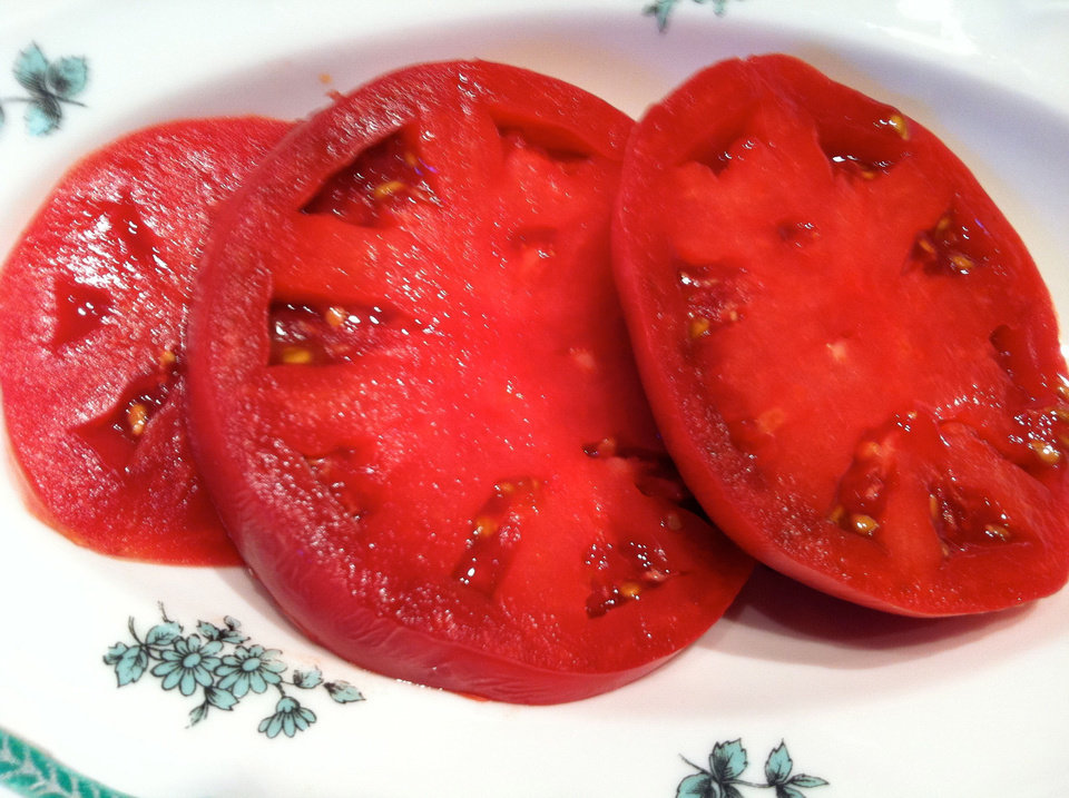 Fresh slices of garden-fresh tomato are a simple, delicious addition to any meal. <strong>SHERREL JONES - THE OKLAHOMAN</strong>