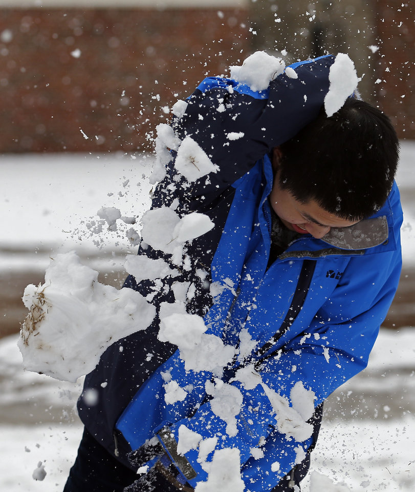 Photo - Will Tang is hit by a snowball at the University of Central Oklahoma in Edmond, Okla., Wednesday, Feb. 13, 2013.Photo by Sarah Phipps, The Oklahoman