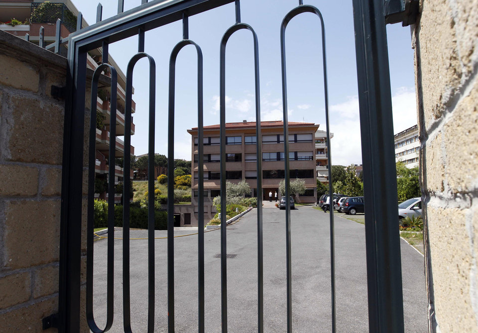 The entrance of the Legion of Christ headquarters in Rome is seen through a gate, Wednesday, May 16, 2012. The Legion of Christ religious order was hit by the second scandal in a week with the admission Tuesday that its most well-known priest, a prominent author, lecturer and television personality, Thomas Williams, had fathered a child. Williams, who is the author of such books as the 2008 book