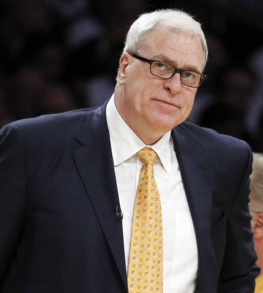 Photo - FILE - In this June 6, 2010 file photo, Los Angeles Lakers coach Phil Jackson watches during the first half of Game 2 of the NBA basketball finals against the Boston Celtics, in Los Angeles. Carmelo Anthony says he has heard that 11-time NBA champion coach Phil Jackson will be