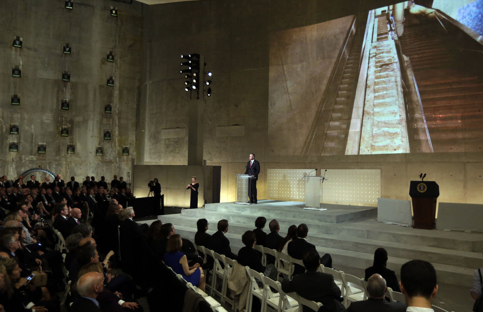 Photo - New York Mayor Bill DeBlasio delivers his remarks during the dedication ceremony in Foundation Hall, of the National September 11 Memorial Museum, as a photo of the