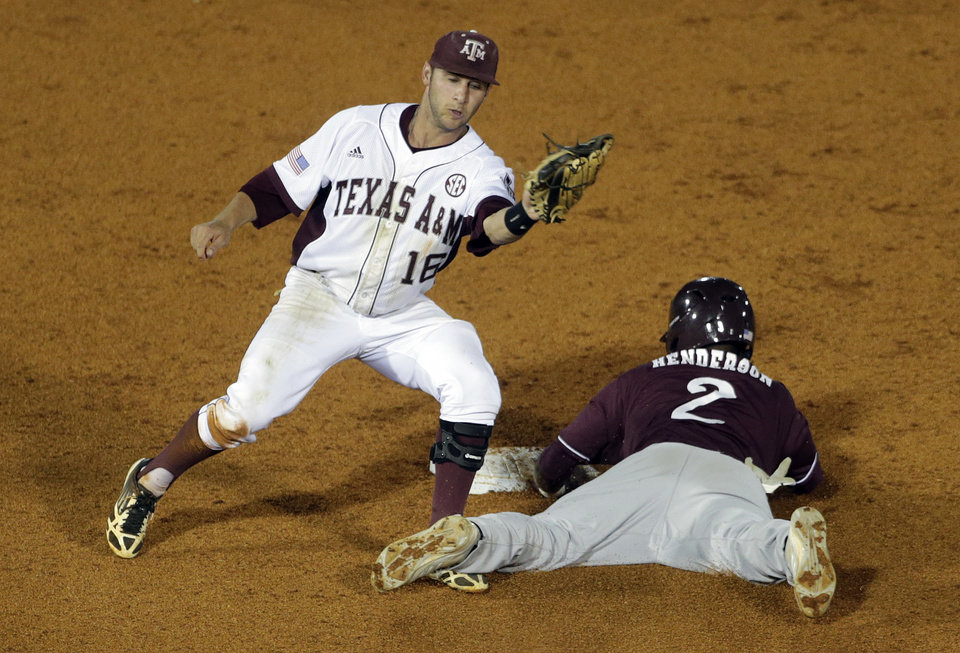 Photo - Mississippi State's Demarcus Henderson (2) safely steals second base as Texas A&M's Mikey Reynolds defends in the fourth inning of their Southeastern Conference Tournament NCAA college baseball game at the Hoover Met in Hoover, Ala., Thursday, May 23, 2013. (AP Photo/Dave Martin)