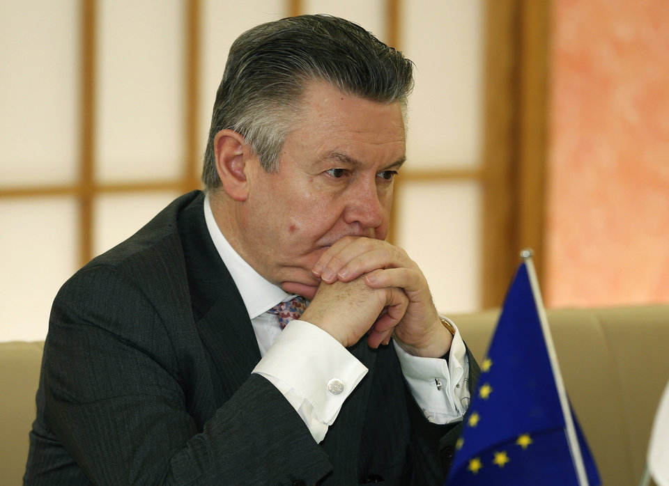 Photo - European Trade Commissioner Karel De Gucht listens to Japanese Foreign Minister Fumio Kishida speak at Japan's Foreign Ministry in Tokyo, Monday, March 25, 2013. Japan's prime minister will discuss a possible free trade pact with the European Union even as a summit in Tokyo to launch the negotiations is postponed because of the financial crisis in Cyprus. De Gucht is in Tokyo and meeting with Japanese government and business officials as scheduled. (AP Photo/Shizuo Kambayashi)