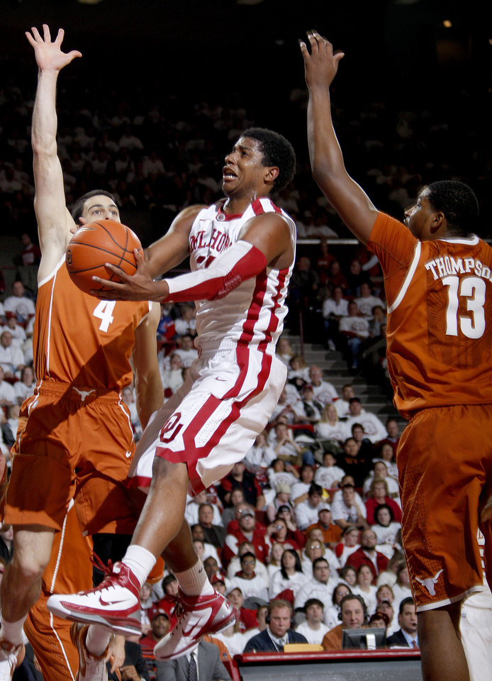 Photo - Oklahoma's Carl Blair Jr. (14) goes between Texas' Dogus Balbay, left, and Tristan Thompson during the NCAA college basketball game between the University of Oklahoma Sooners and Texas Longhorns at Lloyd Noble Center in Norman, Okla., Wednesday, Feb. 9, 2011. Photo by Bryan Terry, The Oklahoman
