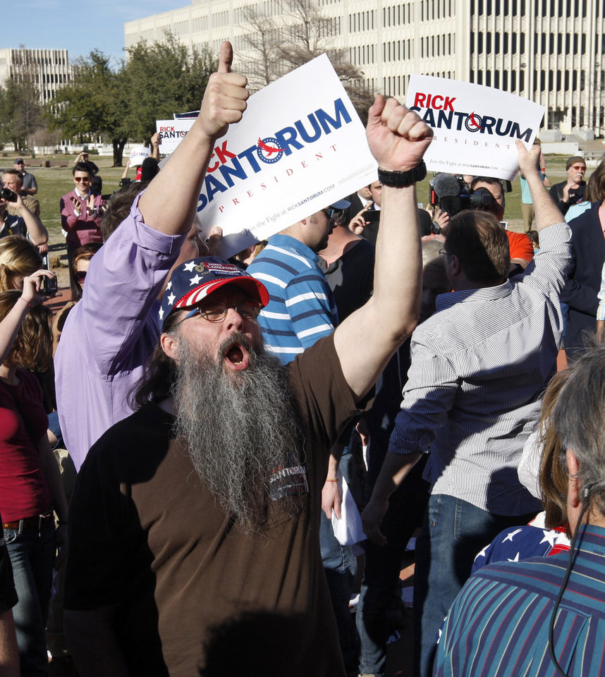 Photo - Republican presidential candidate former Pennsylvania Sen. Rick Santorum supporters cheer in an effort to drown out anti-Santorum demonstrators during a rally in Oklahoma City, Sunday, March 4, 2012. (AP Photo/Sue Ogrocki) ORG XMIT: OKSO103