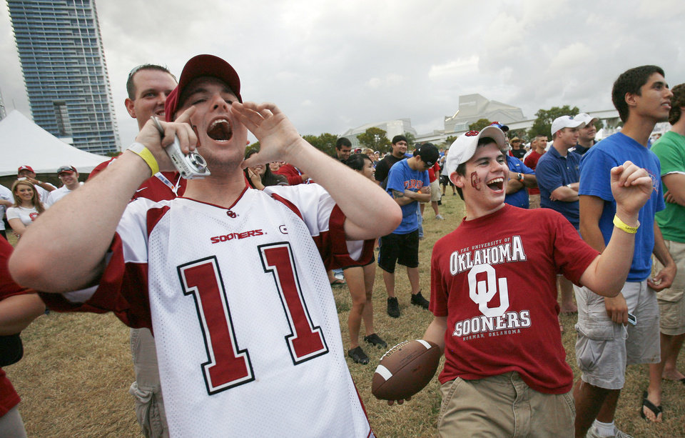 University of Oklahoma fans Devon Newsom, left, of Norman and Kyle Decocq, right, of Yukon cheer Wednesday during a dance competition at Fanfest in Miami, Fla. OU and Florida meet tonight in the BCS  National Championship game. AP PHOTO