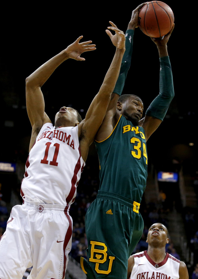 Photo - Baylor's Cory Jefferson (34) grabs a rebound beside Oklahoma's Isaiah Cousins (11) during the Big 12 Tournament college basketball game between the University of Oklahoma and Baylor at the Sprint Center in Kansas City, Mo., Thursday, March 13, 2014. Baylor won 78-73.  Photo by Bryan Terry, The Oklahoman