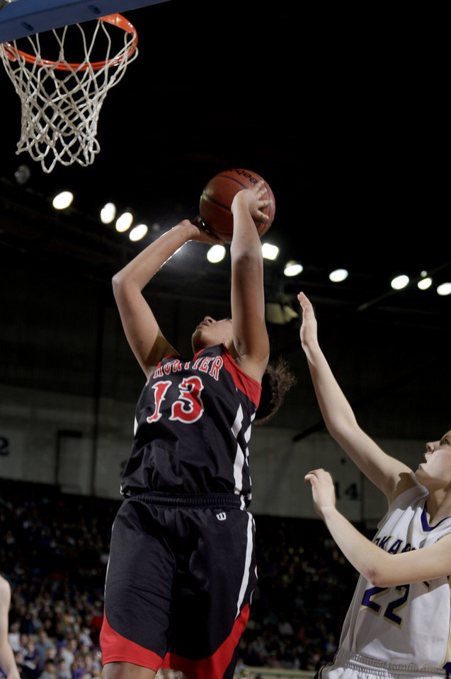 Photo - Frontier's Marissa Goodman shoots as Okarche's Kanadey Grellner defends Class A girls state championship high school basketball game between Okarche and Frontier  at the State Fair Arena in Oklahoma City,  Saturday, March 3, 2012. Photo by Sarah Phipps, The Oklahoman