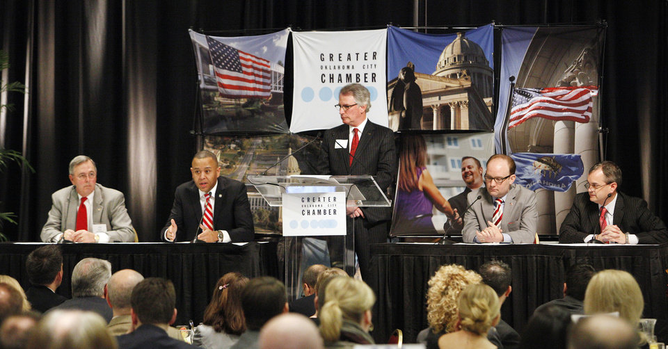 Photo - Speaker of the House T.W.  Shannon, second from left, responds to a question while participating in a panel discussion with Sen. Brian Bingman, panel moderator David Rainbolt, vice chairman of government relations for the Greater Oklahoma City Chamber, Rep. Scott Inman and Sen. Sean Burrage during the 2013 Legislative Breakfast sponsored by the Greater Oklahoma City Chamber in Oklahoma City Thursday, Jan. 31, 2013. Photo by Paul B. Southerland, The Oklahoman