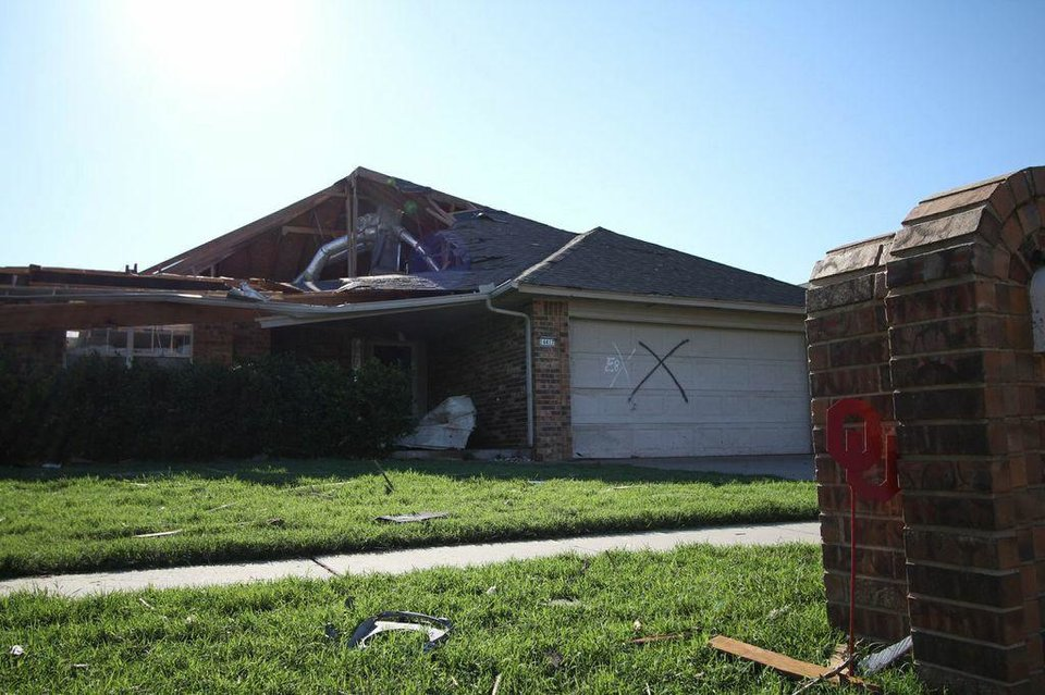 Photo - Monday's tornado took much of the roof of this Westmoor edition house, home to the mom of The Oklahoman's Energy Editor, Adam Wilmoth. Volunteers, neighbors and relief organizations have eased the pain of dealing with the damage and cleanup.  THE OKLAHOMAN - ADAM WILMOTH