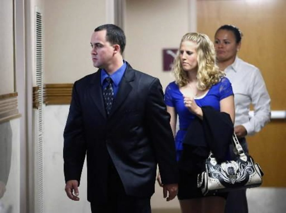Dusten Brown, left, and his wife Robin enter the courtroom, Wednesday, Sept. 4, 2013 at the Muskogee County Courthouse in Muskogee, Okla. Oklahoma Gov. Mary Fallin on Wednesday signed an extradition order to send the father of a Cherokee girl in the middle of a custody dispute to South Carolina to face a criminal charge for refusing to hand his 3-year-old daughter over to her adoptive parents. (AP Photo/Tulsa World, Matt Barnard)