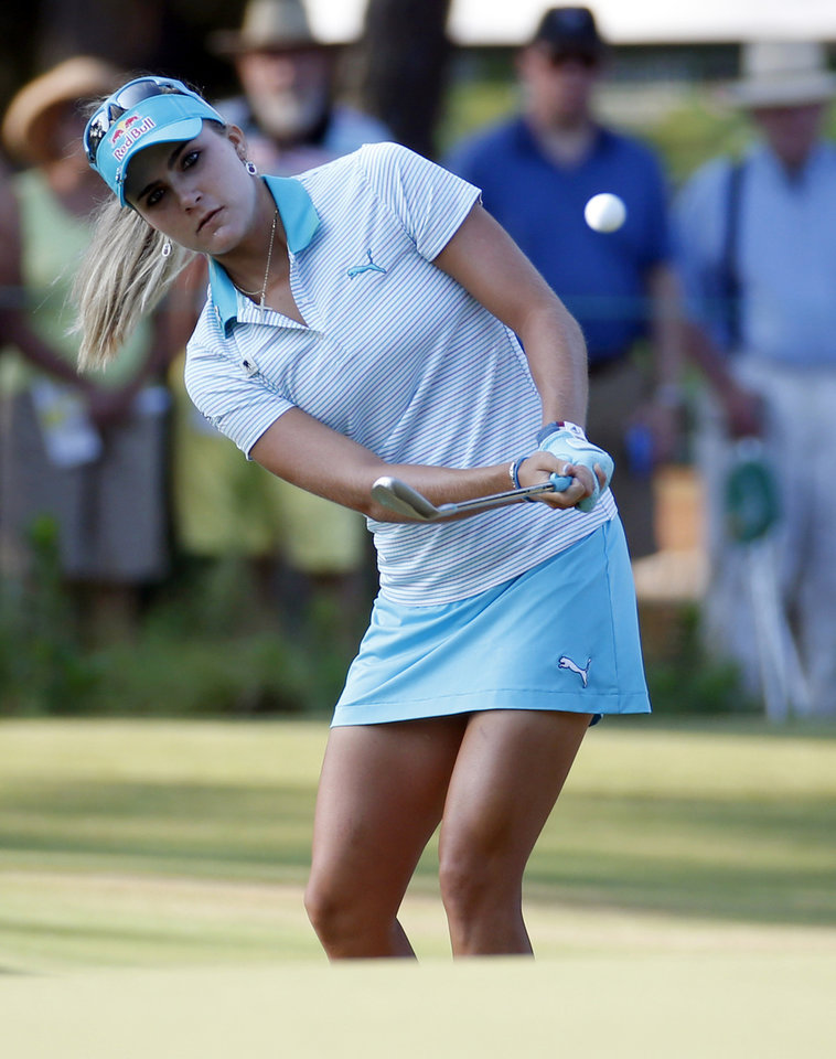 Photo - Lexi Thompson chips to the first green during the first round of the U.S. Women's Open golf tournament in Pinehurst, N.C., Thursday, June 19, 2014. (AP Photo/John Bazemore)