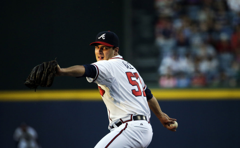Photo - Atlanta Braves starting pitcher David Hale winds up to throw in the first inning of a baseball game against the New York Mets, Thursday, April 10, 2014, in Atlanta. (AP Photo/David Goldman)