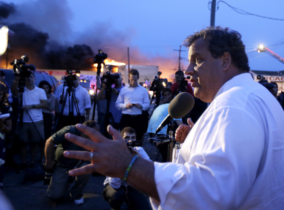 Photo - New Jersey Gov. Chris Christie addresses the media near the area hit by a massive fire on Thursday, Sept. 12, 2013, in Seaside Park, N.J. The fire began in a frozen custard stand on the Seaside Park section of the boardwalk and quickly spread north into neighboring Seaside Heights. (AP Photo/Julio Cortez)