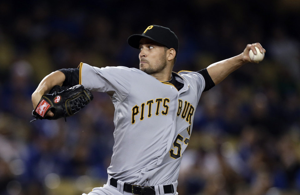 Photo - Pittsburgh Pirates starter Jonathan Sanchez pitches to the Los Angeles Dodgers in the second inning of a baseball game in Los Angeles on Friday, April 5, 2013. (AP Photo/Reed Saxon)