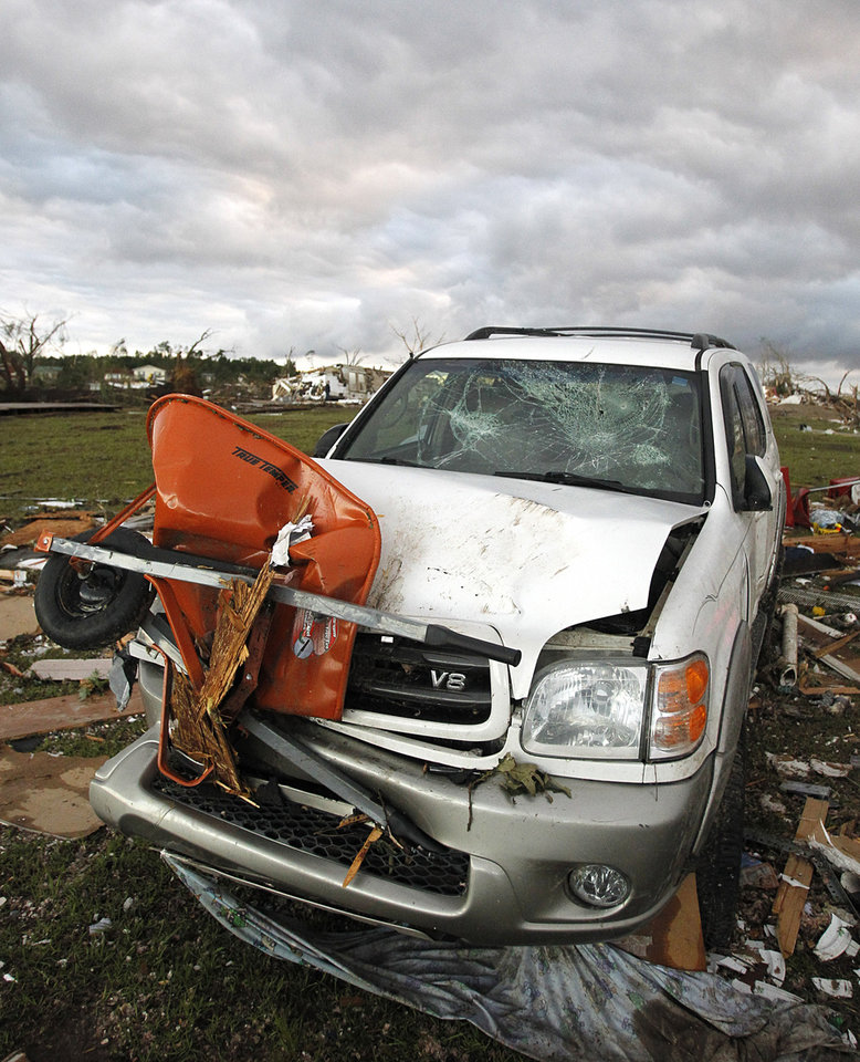 Photo - A vehicle sits damaged after a tornado hit Pleasant Grove just west of downtown Birmingham a day earlier, on Thursday, April 28, 2011, in Birmingham, Ala. (AP Photo/Butch Dill)