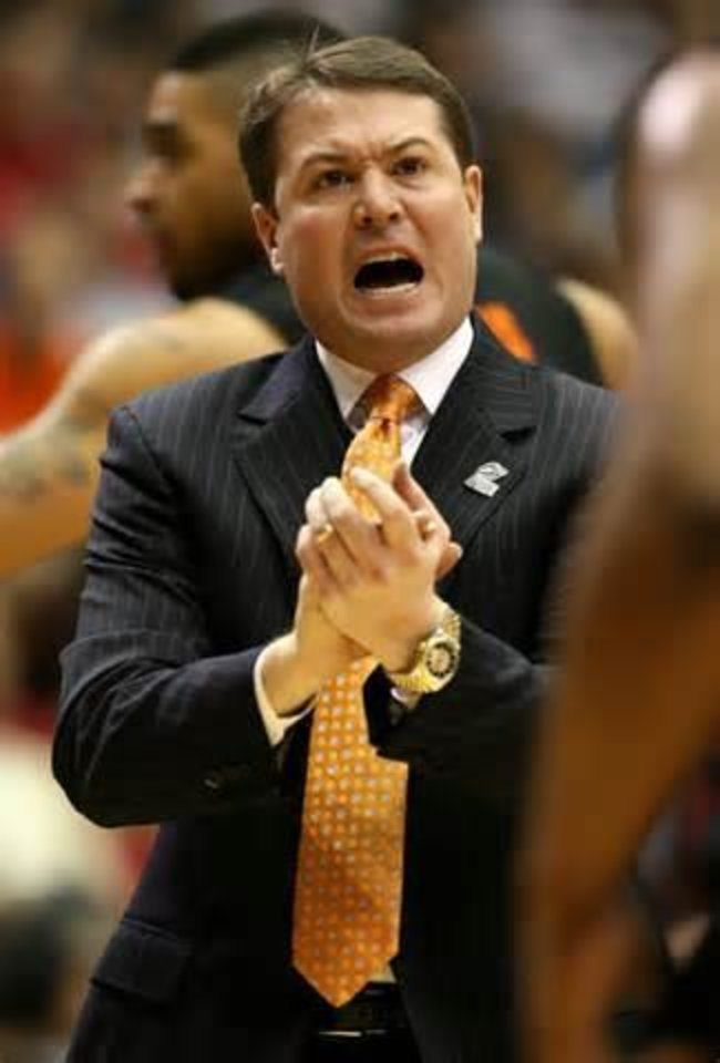 Photo -  Travis Ford will face a familiar coaching foe in Maryland's Mark Turgeon.