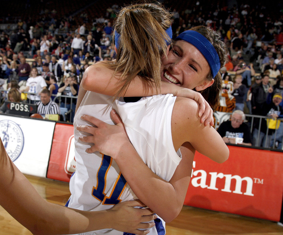 Photo - Newkirk's Hayley Luis and Kaylyn Pulley (15) celebrate their win over Howe in the girls 2A semifinal at the State Fair Arena, Friday, March 13, 2009, in Oklahoma City. PHOTO BY SARAH PHIPPS, THE OKLAHOMAN