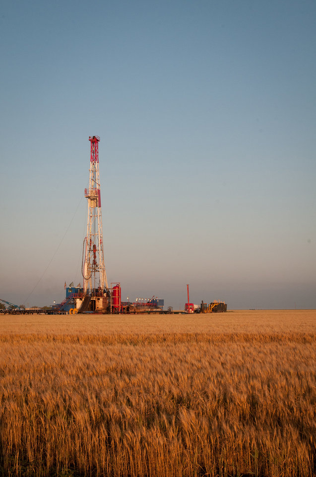 Photo -  A rig works on an enhanced oil recovery well for Chaparral Energy Inc. near Perryton, Texas.    -
