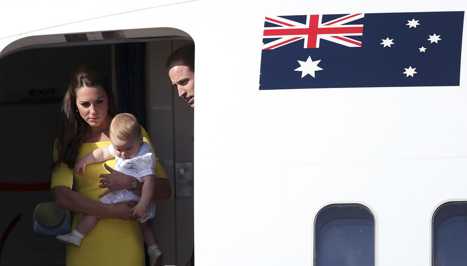 Britain's Prince William, his wife Kate, the Duchess of Cambridge, and their son Prince George arrive in Sydney, Australia, Wednesday, April 16, 2014. The royal family kicked off their tour of Australia. (AP Photo/Rob Griffith)
