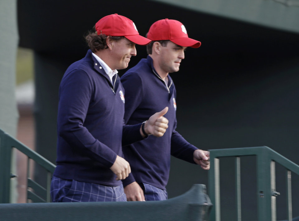 Photo -   USA's Keegan Bradley, right, and Phil Mickelson make their way to the first tee for a foursomes match at the Ryder Cup PGA golf tournament Friday, Sept. 28, 2012, at the Medinah Country Club in Medinah, Ill. (AP Photo/Chris Carlson)