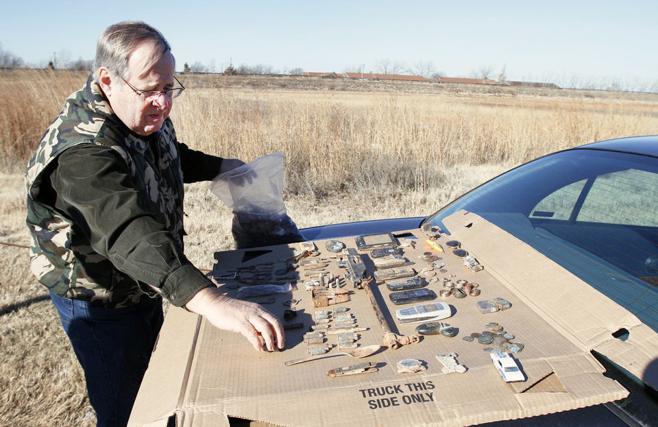 Larry Nowlin displays some of the things he's found.PHOTOS BY STEVE GOOCH, THE OKLAHOMAN