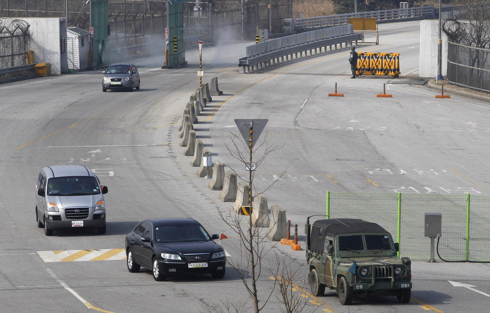 Photo - South Korean vehicles returning from the North Korean city of Kaesong arrive at the customs, immigration and quarantine office in Paju, South Korea, near the border village of Panmunjom, Thursday, April 4, 2013. North Korea on Wednesday barred South Korean workers from entering a jointly run factory park just over the heavily armed border in the North, officials in Seoul said, a day after Pyongyang announced it would restart its long-shuttered plutonium reactor and increase production of nuclear weapons material. (AP Photo/Ahn Young-joon)