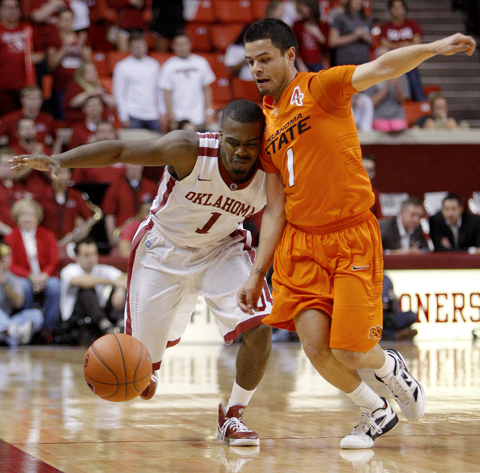 Photo - Oklahoma's Sam Grooms (1) and Oklahoma State's Cezar Guerrero (1) go for a loose ball during the Bedlam men's college basketball game between the University of Oklahoma Sooners and the Oklahoma State Cowboys in Norman, Okla., Wednesday, Feb. 22, 2012. Oklahoma won 77-64. Photo by Bryan Terry, The Oklahoman