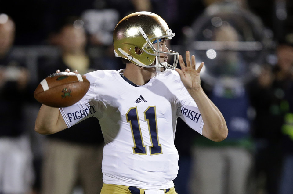 Notre Dame quarterback Tommy Rees throws against Purdue during the first half of an NCAA college football game in West Lafayette, Ind., Saturday, Sept. 14, 2013. (AP Photo/Michael Conroy) ORG XMIT: INMC106