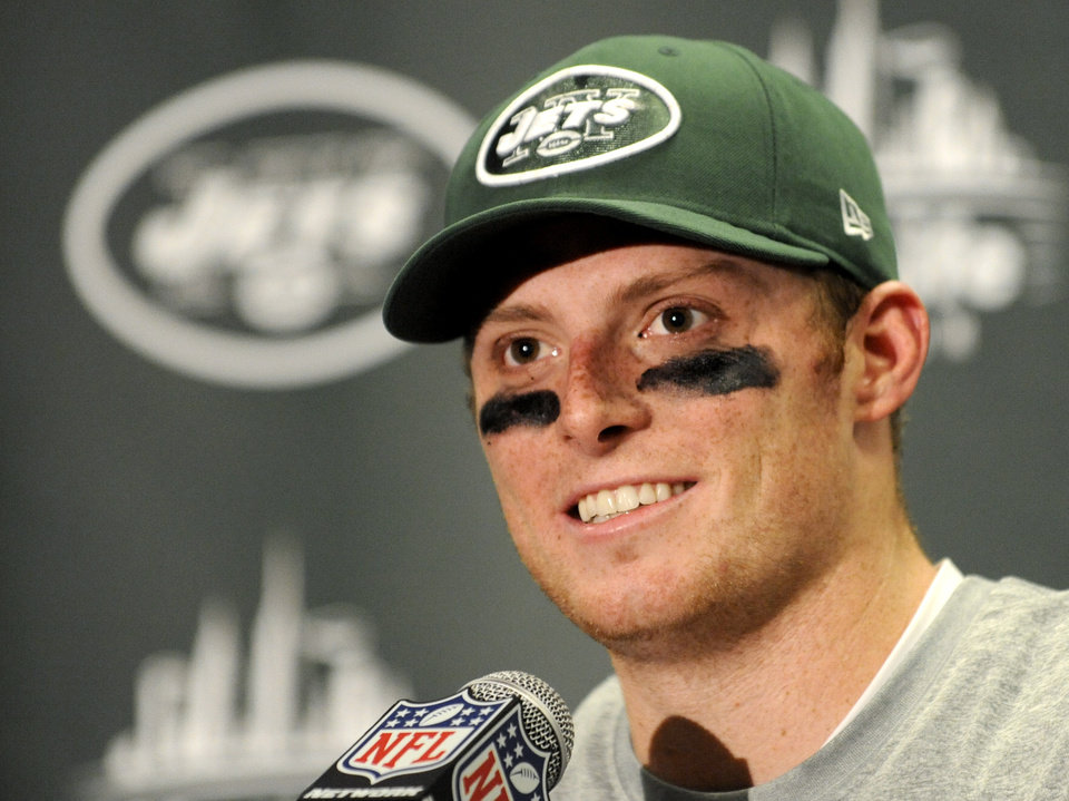 Photo - New York Jets quarterback Greg McElroy talks during a post-game news conference after of an NFL football game against the Arizona Cardinals, Sunday, Dec. 2, 2012, in East Rutherford, N.J. The Jets won 7-6. (AP Photo/Bill Kostroun)