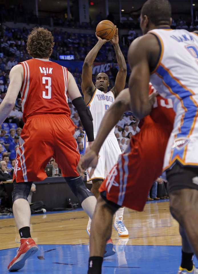 Photo - Oklahoma City's Kendrick Perkins (5) shoots over Houston's Omer Asik (3) during Game 2 in the first round of the NBA playoffs between the Oklahoma City Thunder and the Houston Rockets at Chesapeake Energy Arena in Oklahoma City, Wednesday, April 24, 2013. Photo by Chris Landsberger, The Oklahoman