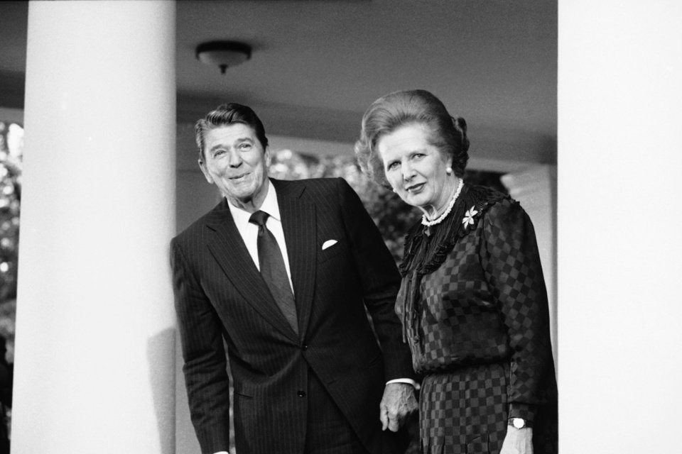 Photo - FILE - In this June 23, 1982 file photo, President Ronald Reagan and British Prime Minister Margaret Thatcher speak to reporters at the White House in Washington.  Ex-spokesman Tim Bell says that Thatcher has died. She was 87. Bell said the woman known to friends and foes as