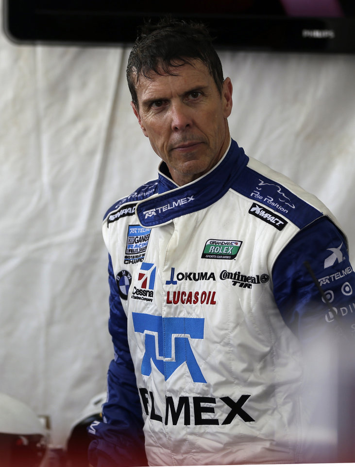 Driver Scott Pruett walks through his pit stall after a turn driving in the Grand-Am Series Rolex 24 hour auto race at Daytona International Speedway, Sunday, Jan. 27, 2013, in Daytona Beach, Fla. (AP Photo/John Raoux)