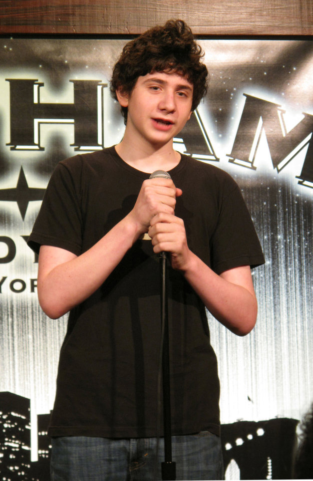 "In this Dec. 16, 2012 photo, 14-year-old comedian Zach Rosenfeld performs his stand-up routine during the ""Kids 'N Comedy"" show at Gotham Comedy Club in New York. Children can get grownup laughs at a monthly comedy show in Manhattan where homework, parents and the awkwardness of adolescence rule the stage. (AP Photo/Larry Neumeister)"