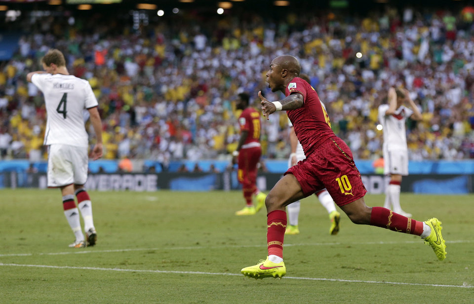 Photo - Ghana's Andre Ayew celebrates after scoring his sides' first goal during the group G World Cup soccer match between Germany and Ghana at the Arena Castelao in Fortaleza, Brazil, Saturday, June 21, 2014. (AP Photo/Marcio Jose Sanchez)