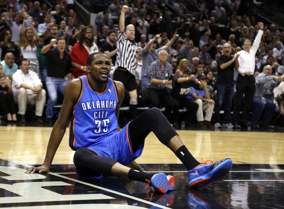 Photo - Oklahoma City's Kevin Durant (35) argues for a call during Game 5 of the Western Conference Finals in the NBA playoffs between the Oklahoma City Thunder and the San Antonio Spurs at the AT&T Center in San Antonio, Thursday, May 29, 2014. Photo by Sarah Phipps, The Oklahoman