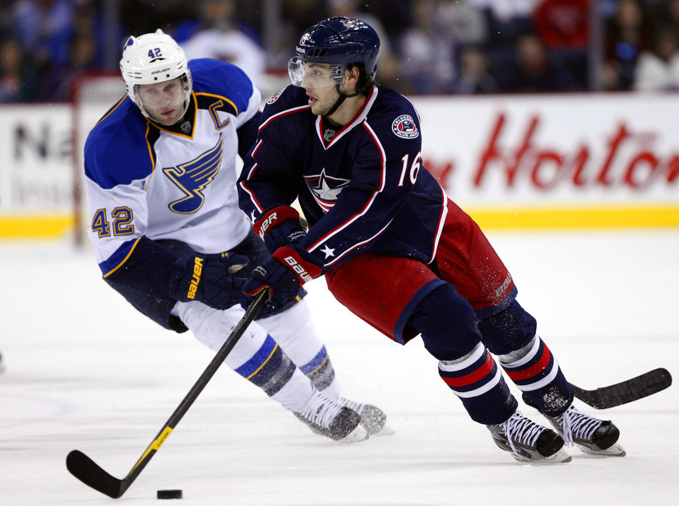 Photo - FILE - In this Feb. 14, 2012, file photo, Columbus Blue Jackets' Derick Brassard (16) controls the puck ahead of St Louis Blues' David Backes (42) during the third period of an NHL hockey game in Columbus, Ohio. A new team president, a sort of new head coach and six or seven new faces on the roster have the Blue Jackets looking for improvement as they head into the new, shortened NHL season. (AP Photo/Terry Gilliam, File)