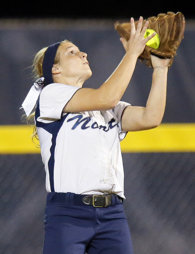 Edmond North's Bridget White (5) catches a fly ball during the 6A state championship fast-pitch softball game between Edmond North and Moore at ASA Hall of Fame Stadium in Oklahoma City, Monday, Oct. 15, 2012. Edmond North won, 11-2. Photo by Nate Billings, The Oklahoman