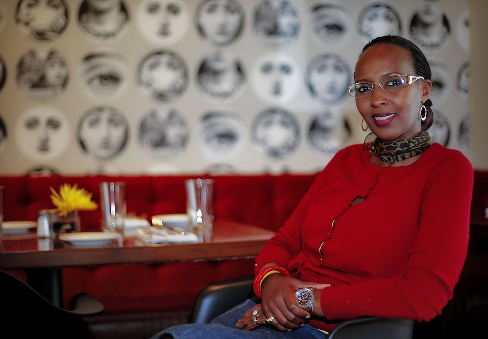 Photo - Rwandan student Fina Uwineza poses for a photo Tuesday at the restaurant Stella in Oklahoma City. Uwineza is part of the mentorship offered through the Peace Through Business program of the Institute for Economic Empowerment of Women.  Photo by Chris Landsberger, The Oklahoman