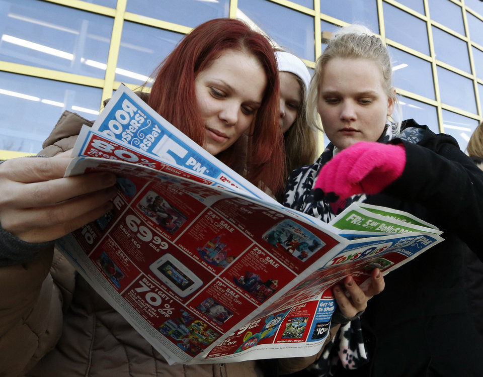 Photo - Sister shoppers Kayla Gouthier, Madeline Mee, 15, and Emily Mee, 16, get an early start on Black Friday as they wait in line at Toys