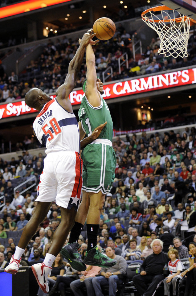 Photo -   Washington Wizards center Emeka Okafor (50) defends the basket against Boston Celtics guard Courtney Lee (11) during the first half of an NBA basketball game on Saturday, Nov. 3, 2012, in Washington. (AP Photo/Nick Wass)
