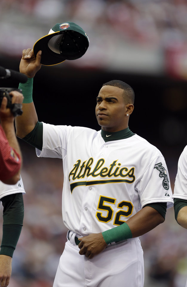 Photo - American League outfielder Yoenis Cespedes, of the Oakland Athletics, waves to the crowd before the MLB All-Star baseball game, Tuesday, July 15, 2014, in Minneapolis. (AP Photo/Jeff Roberson)