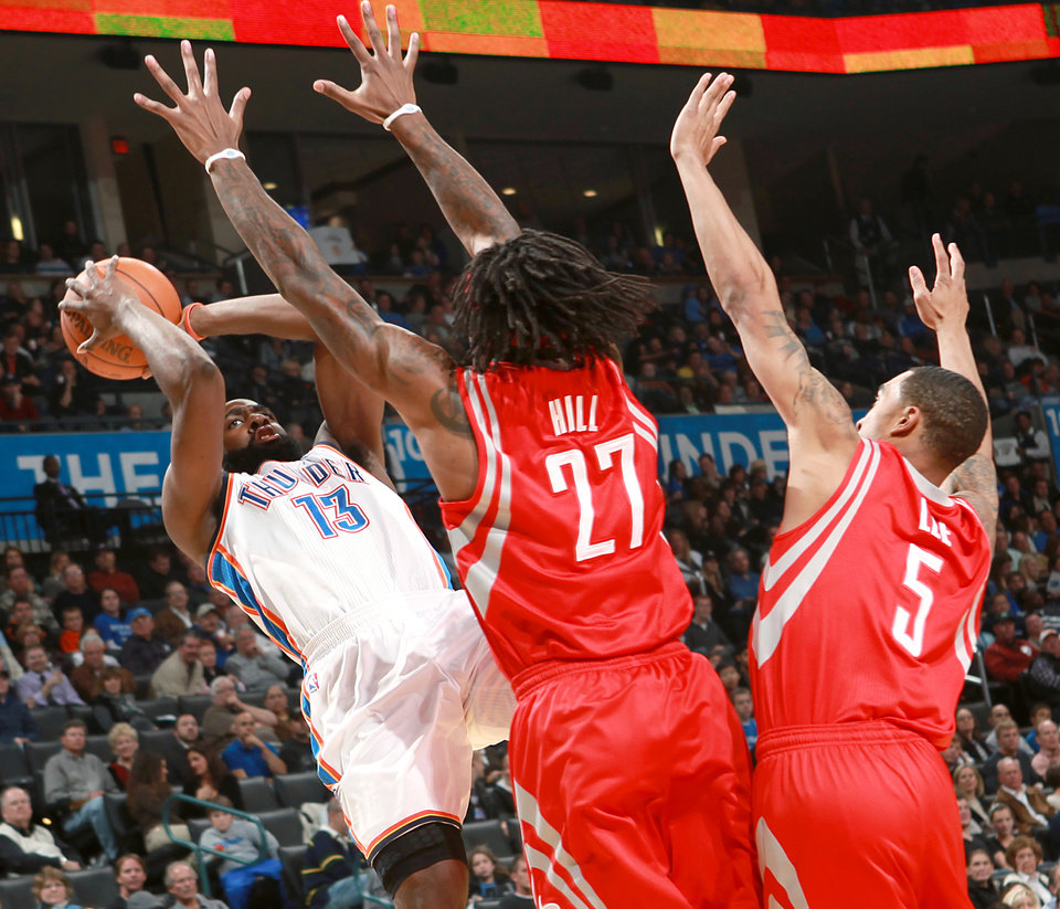 Oklahoma City's James Harden puts up a shot in front of pressure from Houston's Jordan Hill and Courtney Lee during their NBA basketball game at the OKC Arena in downtown Oklahoma City on Wednesday, Nov. 17, 2010. Photo by John Clanton, The Oklahoman