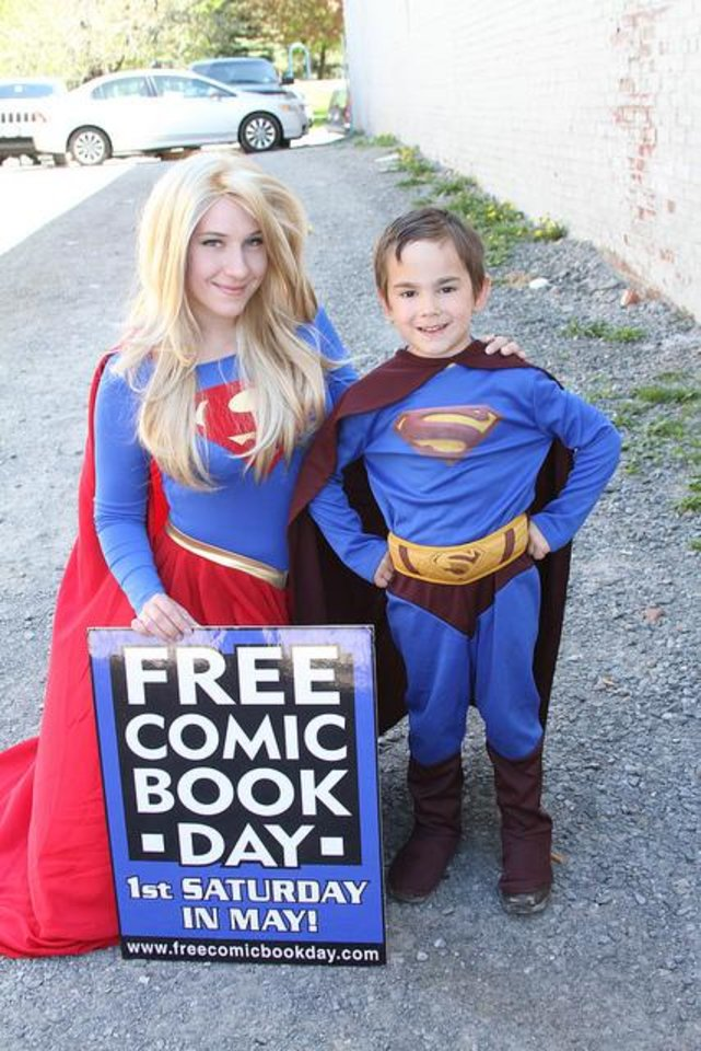 Photo - Fans dressed as Supergirl and Superman celebrate Free Comic Book Day.  Photo provided by Diamond Comic Distributors