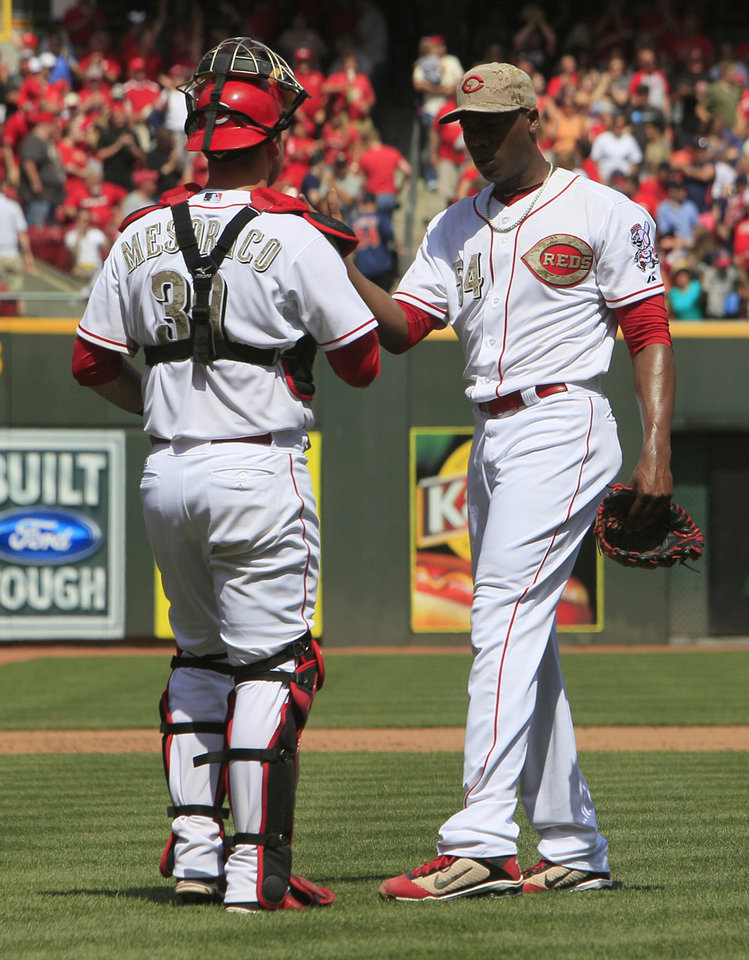 Photo - Cincinnati Reds relief pitcher Aroldis Chapman, right, is congratulated by catcher Devin Mesoraco, left, after beating the Cleveland Indians 4-2 during a baseball game, Monday, May 27, 2013, in Cincinnati. (AP Photo/David Kohl)